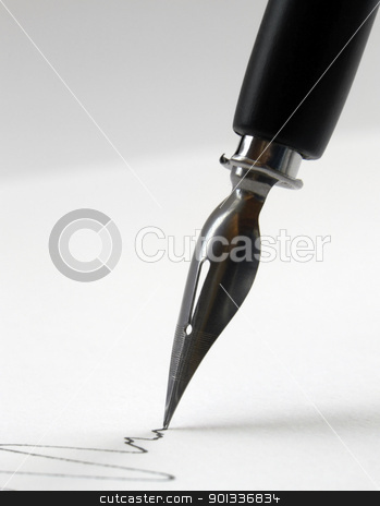 nib tip closeup stock photo, detail of a nib tip while drawing a line in light back by prill