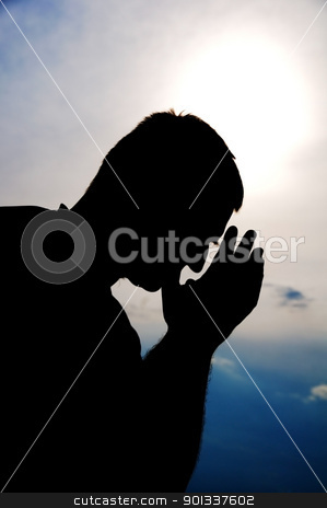 Prayer silhouette stock photo, Praying man. Silhouette. by Iryna Rasko