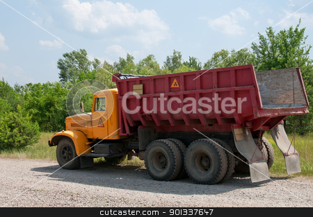 Radioactive dumper truck stock photo, Dumper truck with radioactive sign. This car is eliminating radioactive contamination in Chernobyl area, Ukraine. by Iryna Rasko