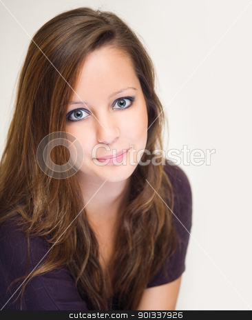 Friendly young brnuette woman. stock photo, Closeup portrait of friendly young brunette woman. by exvivo