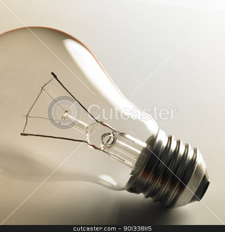clear light bulb stock photo, closeup studio photography of a clear electric bulb in light back by prill