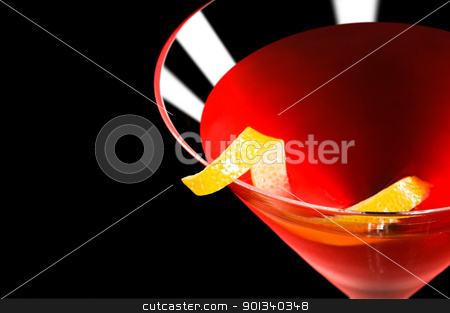 Cosmopolitan cocktail in front of a black background stock photo, Cosmopolitan cocktail in nice red color in front of a black background by Ulrich Schade