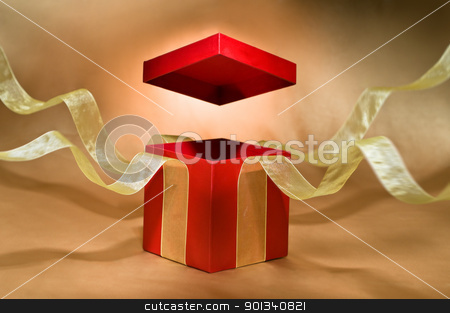 Red Present Box with open cover stock photo, Red Present Box with open cover and yellow flying ribbon by Ulrich Schade