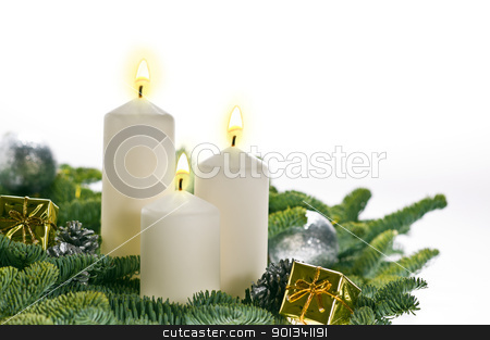 Three candles in advent setting  stock photo, Three candles in advent setting with real Christmas tree branches by Ulrich Schade