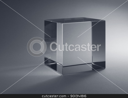 solid glass cube stock photo, studio photography of a solid glass cube in grey back by prill