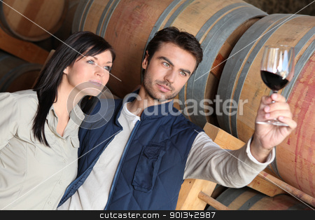 Couple wine tasting in a cellar stock photo, Couple wine tasting in a cellar by photography33