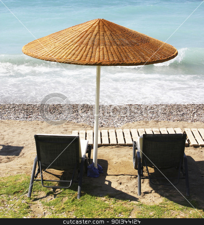 Beach chairs and umbrella stock photo, Beach chairs and umbrella on a beach by Georgios Kollidas