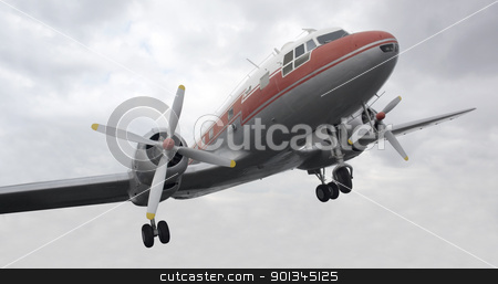 nostalgic propeller aircraft stock photo, dynamic shot of a nostalgic aircraft and cloudy sky by prill