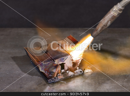melting heat sink stock photo, melting heat sink and welding torch on metallic ground by prill