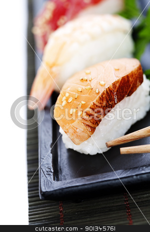 sushi stock photo, set of japanese sushi with chopsticks over white by klenova