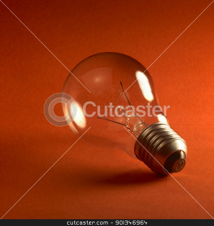 light bulb stock photo, studio photography of a light bulb in red back by prill