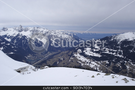 ski lift and mountains in Montafon stock photo, alpine scenery in Montafon (Austria) with clouded sky by prill