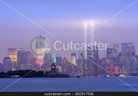 New York City Manhattan downtown night stock photo, New York City Manhattan downtown skyline at night with statue of liberty and light beams in memory of September 11 viewed from New Jersey waterfront. by rabbit75_cut