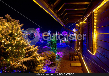 Christmas fantasy - trees and wooden house in lights stock photo, Christmas fantasy - trees and wooden house in lights on a beautiful winter evening by xbrchx