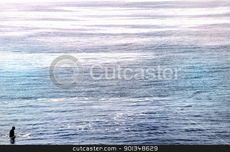Lone Surfer  stock photo, Lone surfer sitting in vast open wide ocean by Juliet N Newton