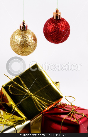 Christmas decorations stock photo, Red and Gold ball and wrapped presents by Juliet N Newton