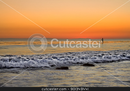 Paddle boarder surfer sunset stock photo, solitary paddle boarder surfer at sunset sunrise by Juliet N Newton