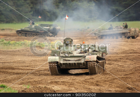 offroad scenery with driving tank stock photo, old tank of the Nationale Volksarmee in Germany, now used for a private tank driving school, while driving on earthy ground by prill