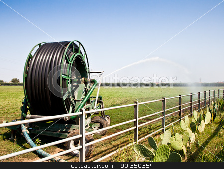 Irrigation stock photo, Irrigation operations in Italian country during a sunny day by Perseomedusa