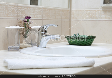 Hotel bathroom stock photo, Hotel bathroom: sink, tap, towel and bathroom set by Iryna Rasko