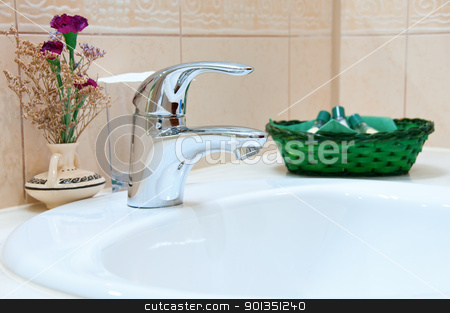 Hotel bathroom stock photo, Hotel bathroom: sink, tap and bathroom set by Iryna Rasko