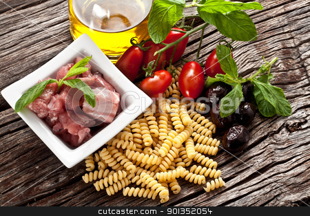 Italian Fusilli pasta with swordfish ingredients stock photo, Italian Fusilli pasta with swordfish, olive and raw tomato ingredients by maxg71