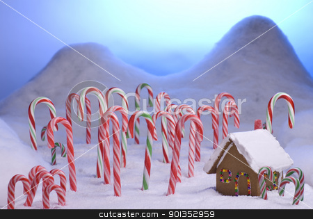 Christmas Candy Cane Forest Blue Sunset stock photo, Ginger bread cottage in a candy cane forest with a blue sunset by saje