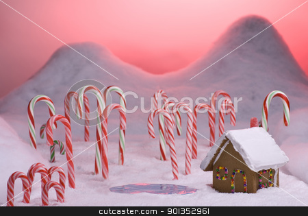 Christmas Candy Cane Forest Pink Sunset Pond stock photo, Ginger bread cottage next to a pond in candy cane forest with pink sunset by saje
