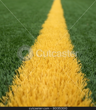 Goal Line stock photo, Close up of yellow goal line on a green american football field by saje