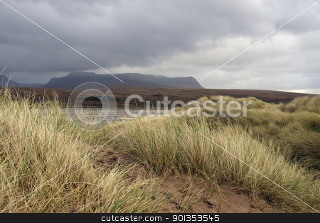 overgrown dunes and dramatic sky stock photo, scottish coastal scenery  in stormy ambiance by prill
