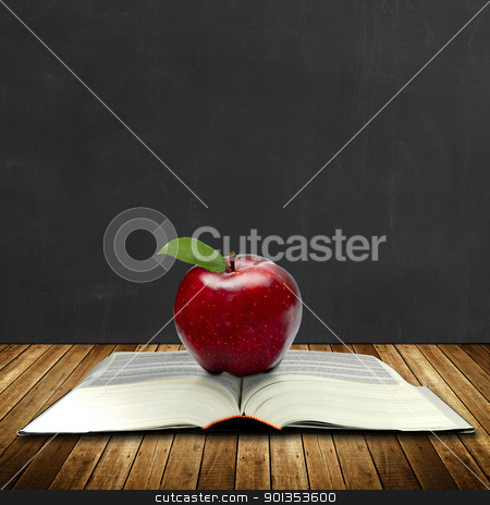 Book of knowledge stock photo, apple on a book with black board at the back by Haider Azim