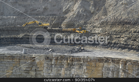 quarry digger and dump trucks stock photo, yellow stone pit digger and dump trucks in stony ambiance by prill