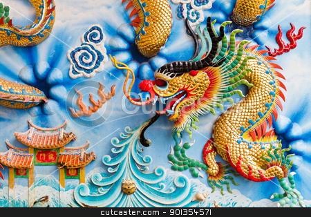 Statue of a dragon on the wall. stock photo, Statue of a dragon on the wall, in a Chinese temple, in the daytime. by Na8011seeiN