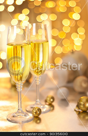 Glasses of Champagne on Christmas Eve stock photo, Photograph of champagne glasses set on a table on christmas eve by mpessaris