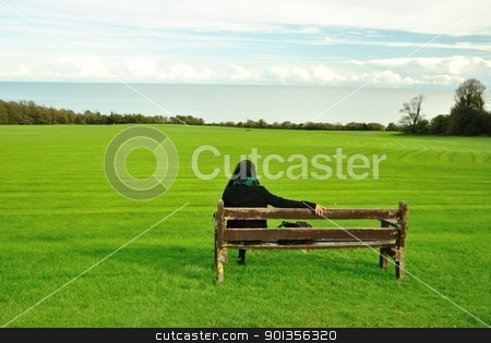 Lonely Woman stock photo, Lonely Woman staring the sea by Toyashoo