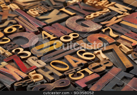letters and numbers stock photo, random letters and numbers in antique wood letterpress printing blocks of various size and style by Marek Uliasz