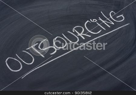 outsourcing word on blackboard stock photo, outsourcing word in white chalk handwriting on blackboard by Marek Uliasz