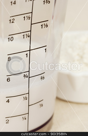 almond milk in blender beaker stock photo, almond milk in blender beaker with ounces and cup scale and a scoop of white powder by Marek Uliasz