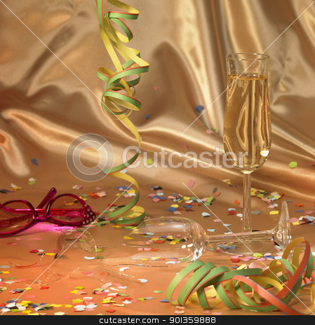 carnival scenery background stock photo, carnival background with a filled and a broken champagne glass in floating satin back with streamers and confetti by prill