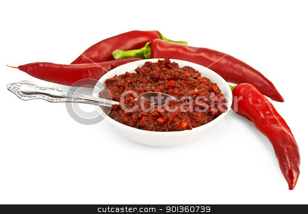 Adjika with fresh hot pepper stock photo, Tabasco in a white cup with spoon, fresh red peppers isolated on white background by rezkrr
