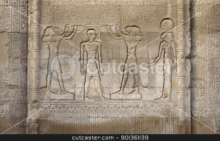 stone relief at the Esana Temple stock photo, architectural detail of the historic Esana Temple in Egypt (Africa) showing a stone relief with some figures and hieroglyphics by prill