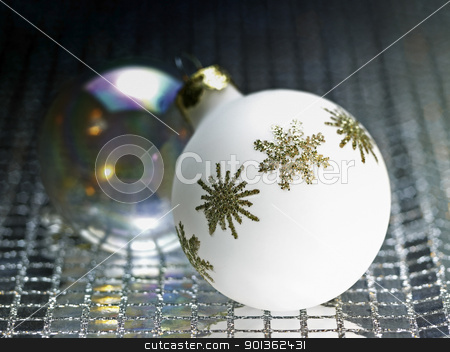 ornamented white christmas bauble stock photo, ornamented white christmas bauble in decorative metallic back by prill