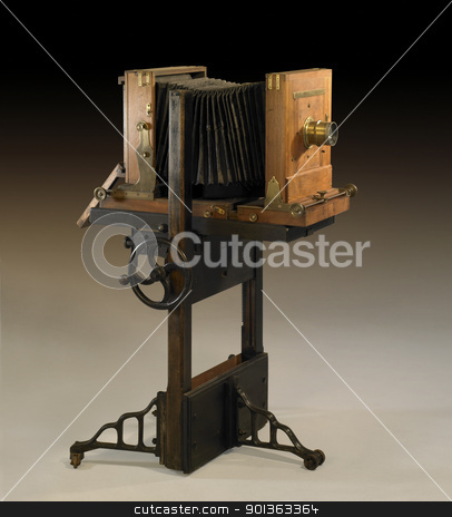 nostalgic wooden camera stock photo, studio shot of a historic wooden camera in brown gradient back by prill