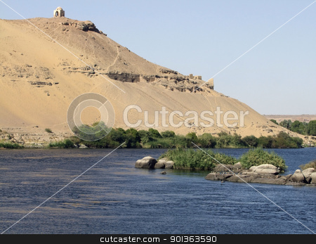 Nile and mausoleum near Aswan stock photo, sunny idyllic scenery showing the Nile and a ancient mausoleum near Aswan in Egypt by prill