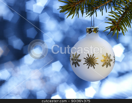 white Christmas bauble in blue back stock photo, Christmas bauble hanging on fir branch in blue blurry back by prill