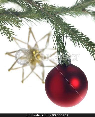 decorative theme with red christmas bauble stock photo, Studio photography of some christmas decoration with red christmas bauble on fir branch and a blurry straw star in the back by prill