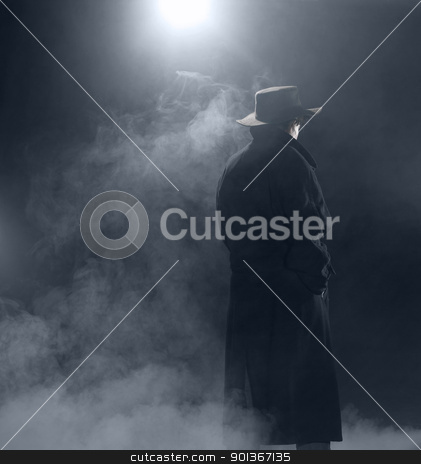 Woman wearing trench coat and standing in fog stock photo, woman with dark coat standing in the fog by prill