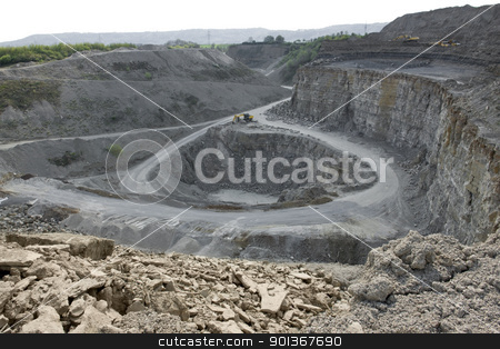 quarry diggers and dump trucks stock photo, yellow stone pit diggers and dump trucks in stony ambiance by prill