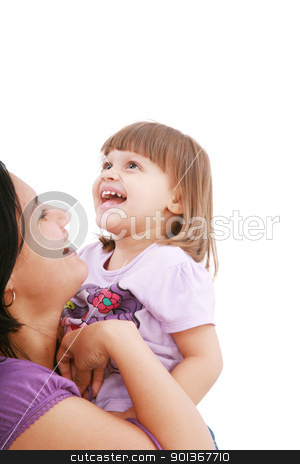 Mother and daughter smiling isolated over a white background. Fo stock photo, Mother and daughter smiling isolated over a white background. Focus in the little girl. by dacasdo
