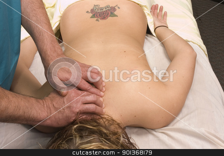 Woman having back massage stock photo, Woman having back massage by Jeffrey Banke